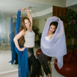 Kaleena and Kendra pose with veils