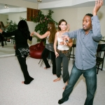 Ian Huggins shows Kendra Ray some different dance styles.