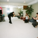 Armineh encourages Kendra and Kaleena while dancing to a drum solo.